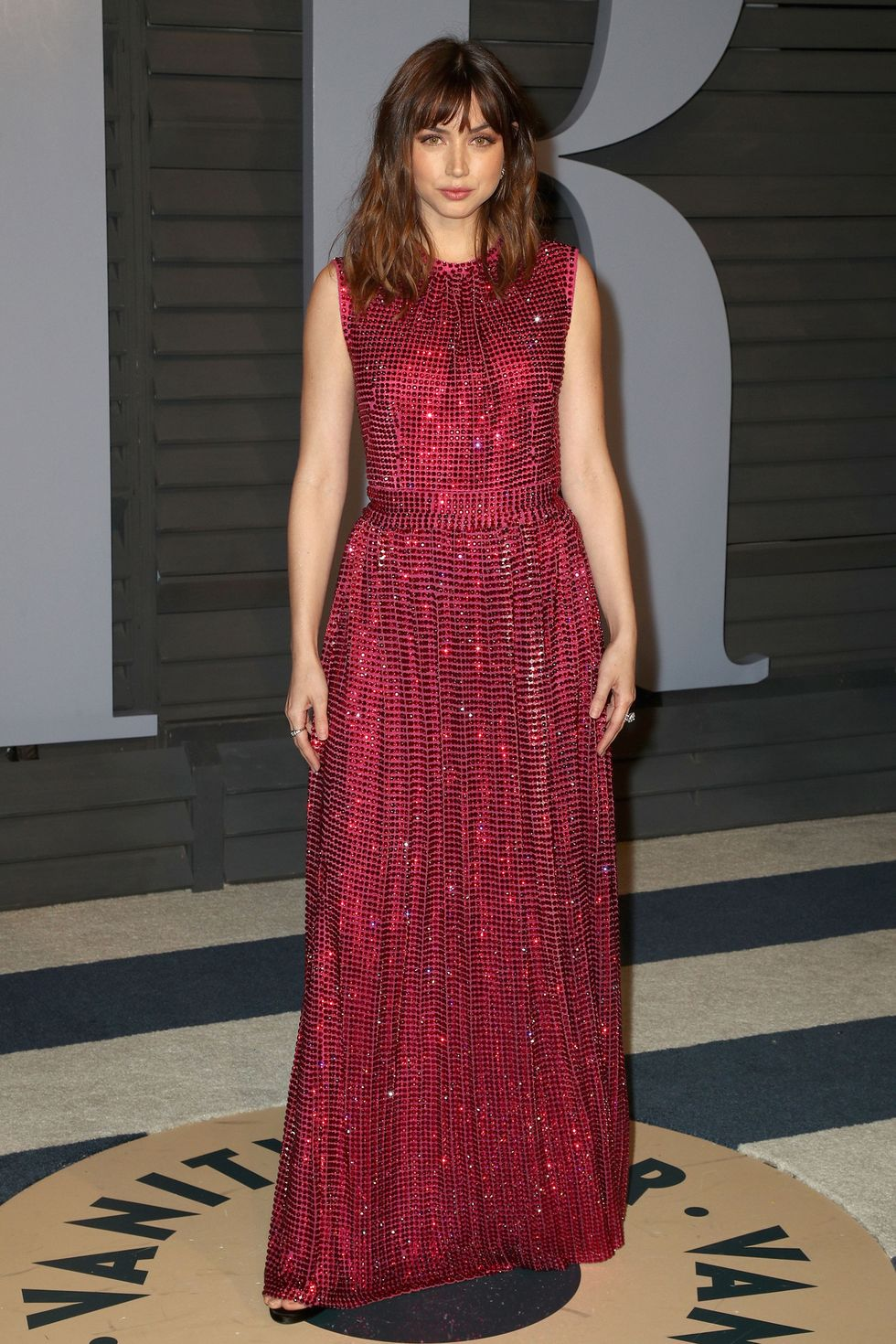 Ana De Armas at Vanity Fair event in red dress by Frederick M. Brown Getty Images