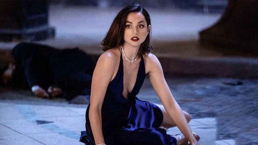 Ana de Armas in No Time to Die wearing black dress movie still